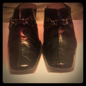 Black heeled clogs